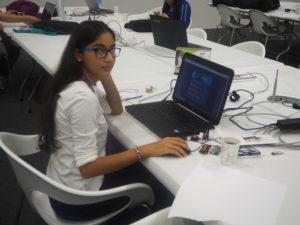 Aydan Huseynova behind her laptop
